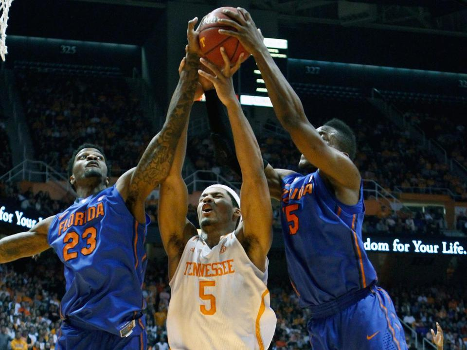 Visiting Florida was too much for Tennessee to handle as the Vols' Jarnell Stokes (5) found in this rebound battle.