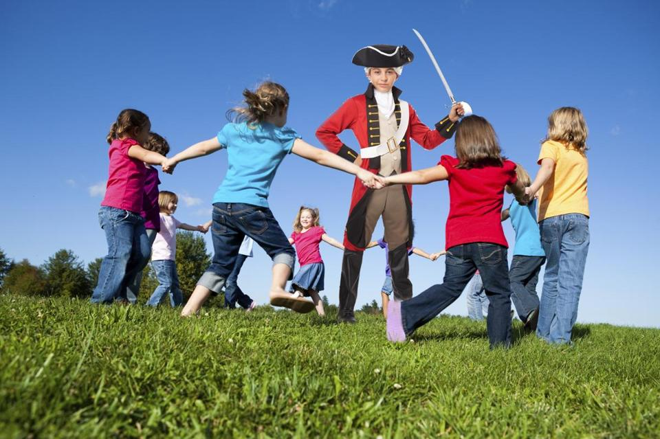 Games for an imaginary holiday: Children playing Ring-Around-the-Redcoat.