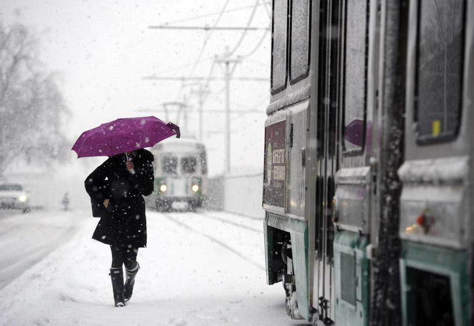 A pedestrian battled her way along the Green Line tracks on Commonwealth Avenue near the Agganis Area.