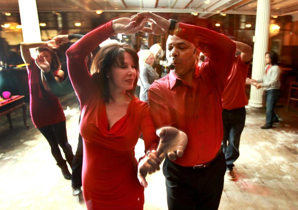 Anna Maria Mancini of Swampscott and Anthony Nicastro of Gloucester  take a turn on the dance floor during the weekly Latin dance party at Rockafellas in Salem.Greg Coles leading Grace Polcaro at Rockafellas in Salem.