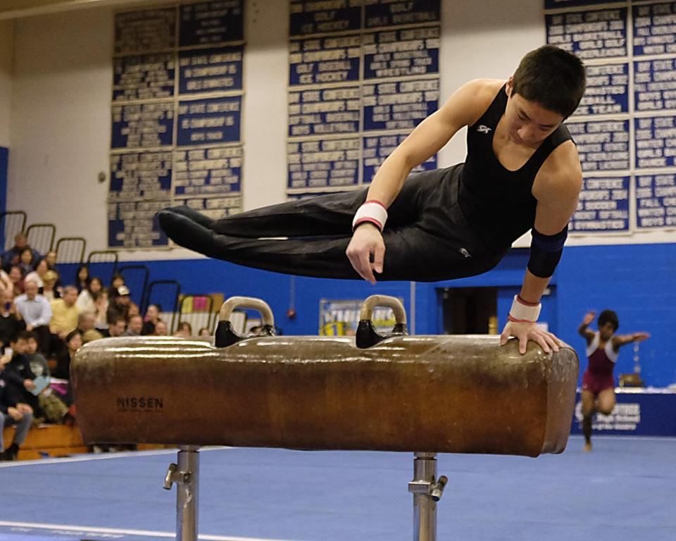 Newton North's Jonathan Wang, the all-around champion, showed fine form on the pommel horse.