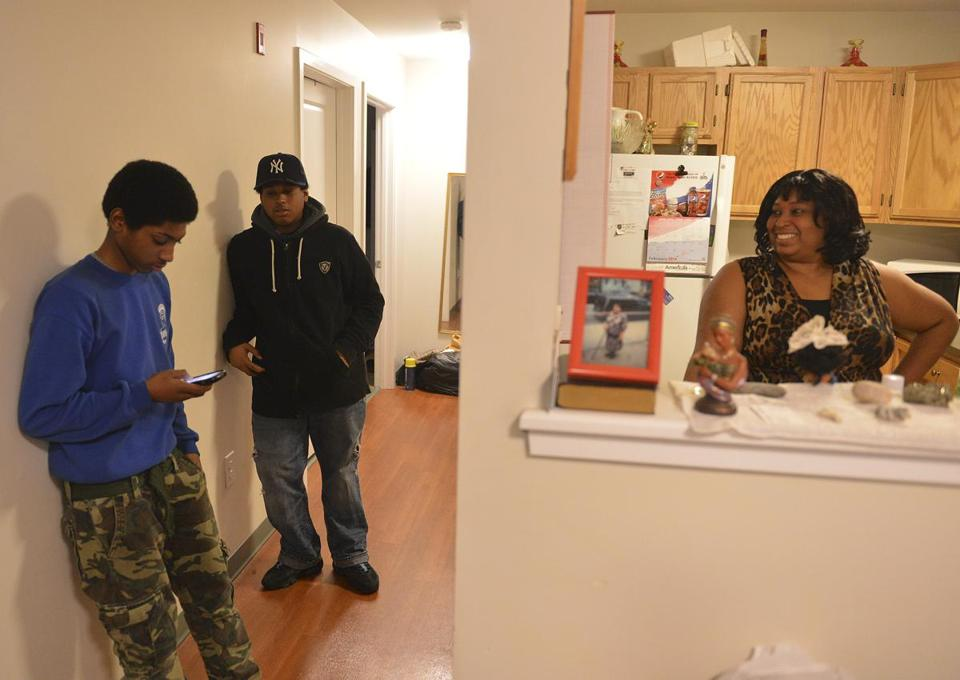 Arlene Carr, shown with sons Malik and Marcus, was laid off in the fall. The money from the earned income tax credit should help her out.