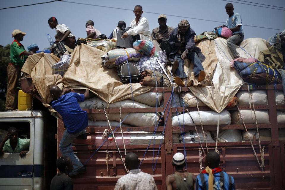 Thousands of Muslims fled in a convoy that tried to move through the capital, the second such mass exodus in a week.