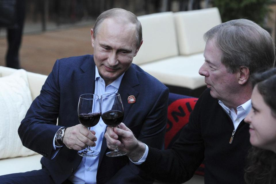 Russia's President Vladimir Putin (L) toasts as he visits Team USA House at the U.S. Olympic Vladimir Putin, left, enjoyed a glass of win in a visit the the Team USA House in Sochi.