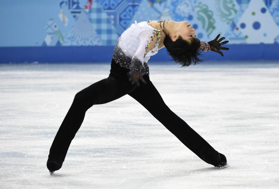 Yuzuru Hanyu of Japan bent over backward to win the gold medal in men's figure skating. (AP Photo/The Canadian Press, Paul Chiasson)