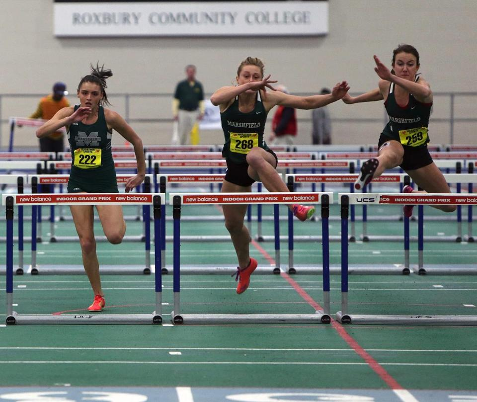 Marshfield's Ellen DiPietro (right) won the 55-meter hurdles in 8.47 seconds and also took first in the high jump (5-8).