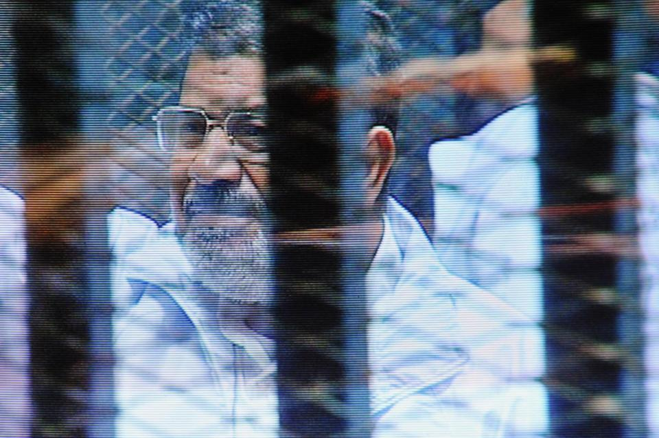 Mohamed Morsi and his codefendants complained that they could not hear the court proceedings.