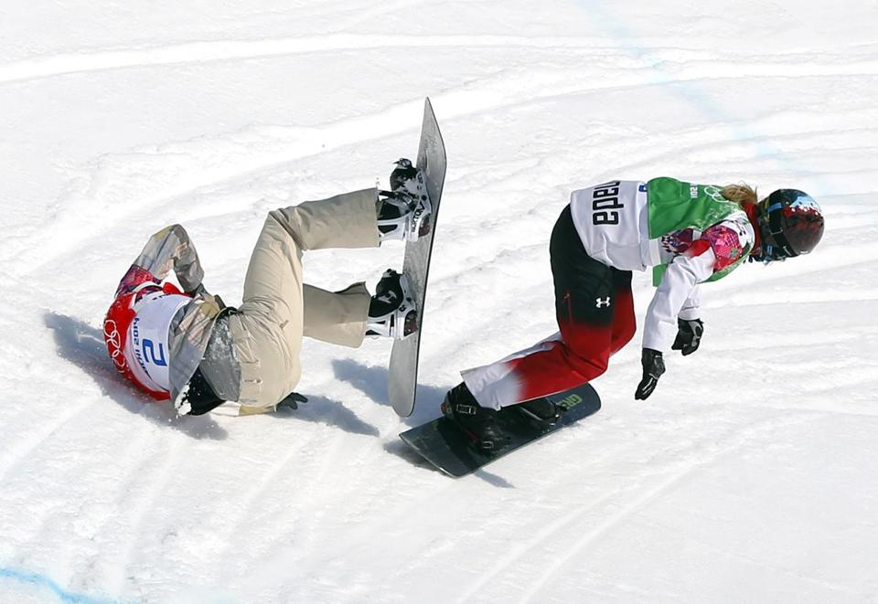 Canada's Dominique Maltais slides past a fallen Lindsey Jacobellis, who lost her balance in the second-to-last turn in a snowboardcross semifinal run.