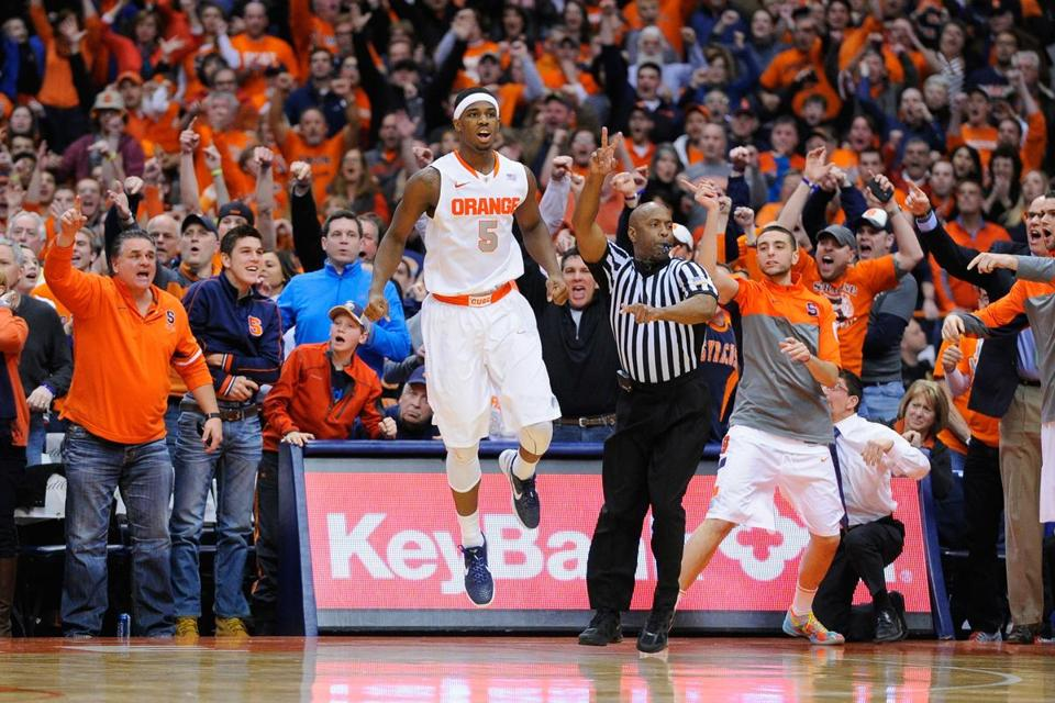 Syracuse forward C.J. Fair jumps for joy after his layup attempt with 6.7 seconds left was goaltended, keeping the No. 1 Orange unbeaten.