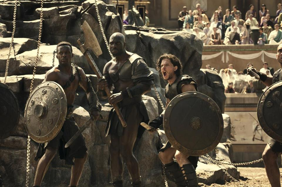 "Atticus (Adewale Akinnouye-Agbaje, center) and Milo (Kit Harington, right) are gladiators in Paul W.S. Anderson's ""Pompeii."""