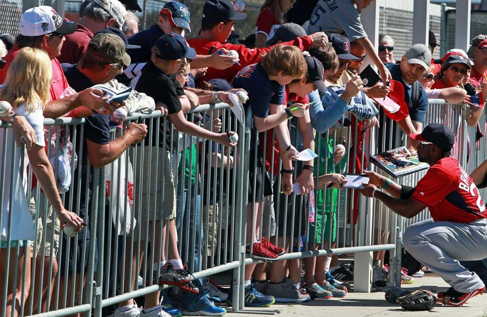 Jackie Bradley, Jr. spent at least 30 minutes signing autographs after practice.