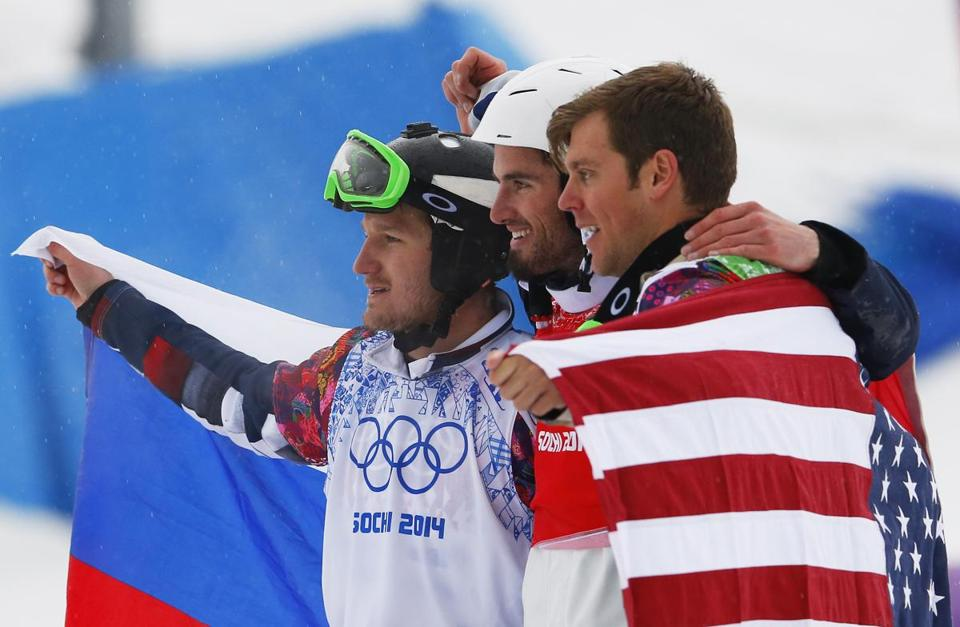 France's Pierre Vaultier, center, celebrates his gold medal with silver medalist Nikolai Olyunin of Russia, left, and bronze medalist Alex Deibold, right, of the United States.