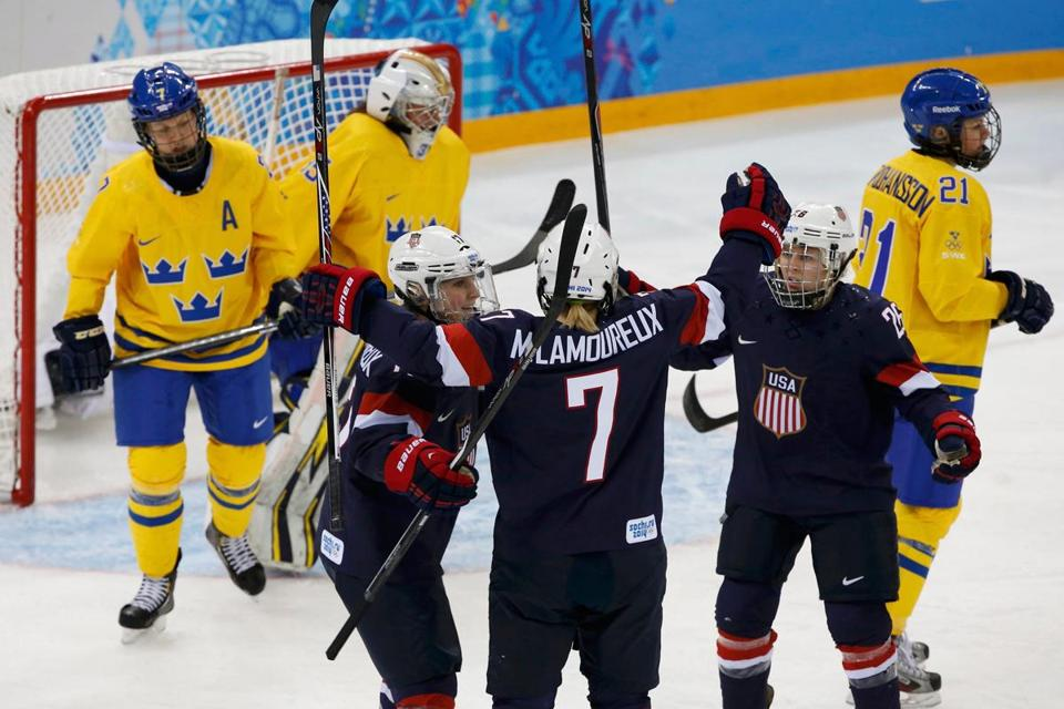 Team USA's Monique Lamoureux (center) celebrates her second-period goal against Sweden with teammates Jocelyne Lamoureux and Kendall Coyne.