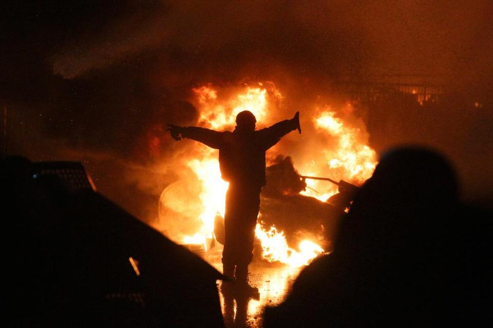Surrounded by fire, antigovernment protesters tried to defend themselves against riot police in Kiev on Tuesday night.