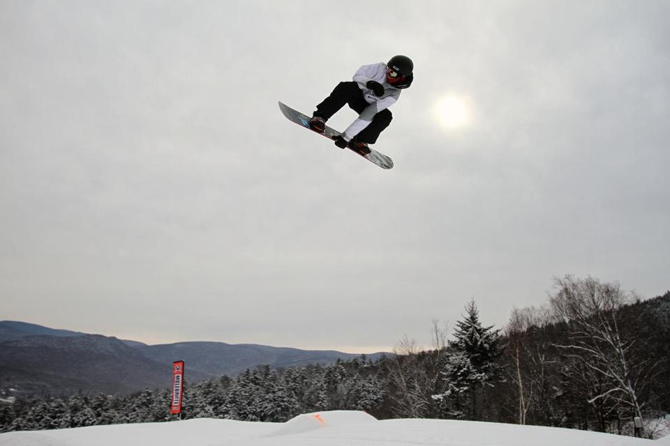 Danny McGonagle, 15, clutched his board as he flew through the air in the terrain park at Waterville Valley.