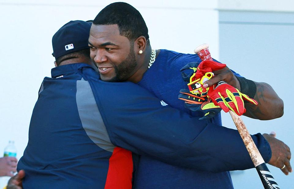 Jim Rice, left, greeted David Ortiz with a hug when the designated hitter arrived at spring training on Monday.