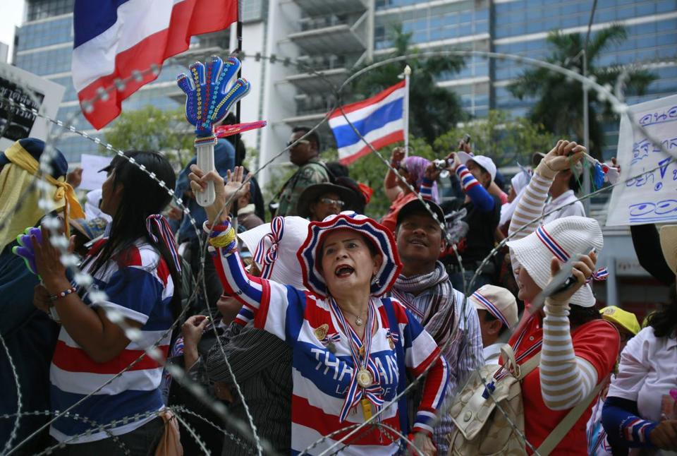 Antigovernment protesters called for the prime minister's resignation during a rally near her office on Wednesday.