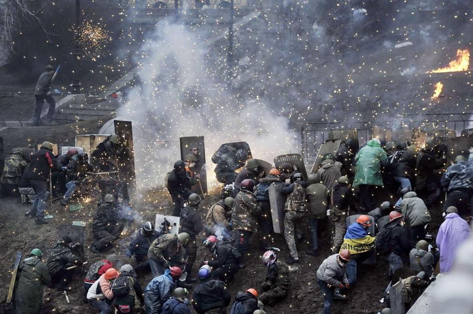 Protesters, aided by ordinary residents, used barricades during clashes with police on Thursday near Kiev's central Independence Square.