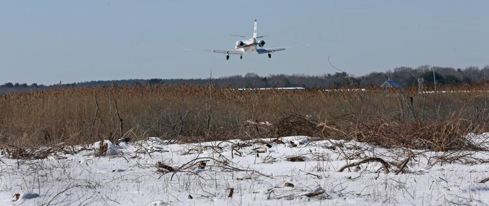 A jet approaches Marshfield Airport over the Bass Creek wetlands.