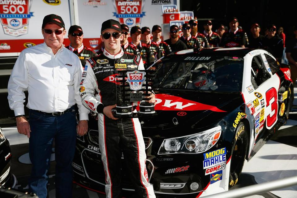Team owner Richard Childress (left) and driver Austin Dillon celebrate capturing the pole position for the upcoming Daytona 500.