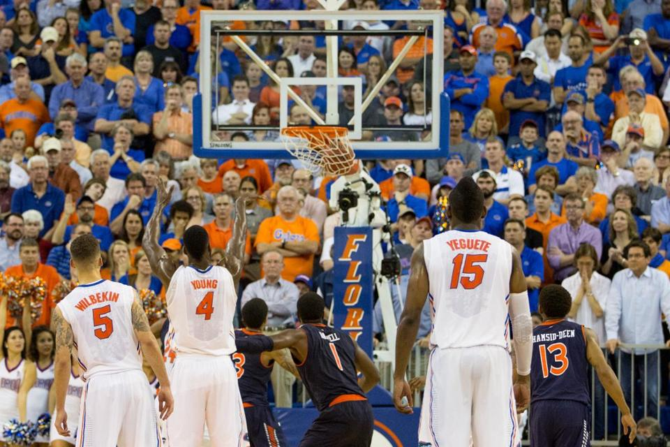 Florida's Patric Young sank a pair of free-throws in the waning seconds to lift the Gators over upset-minded Auburn.