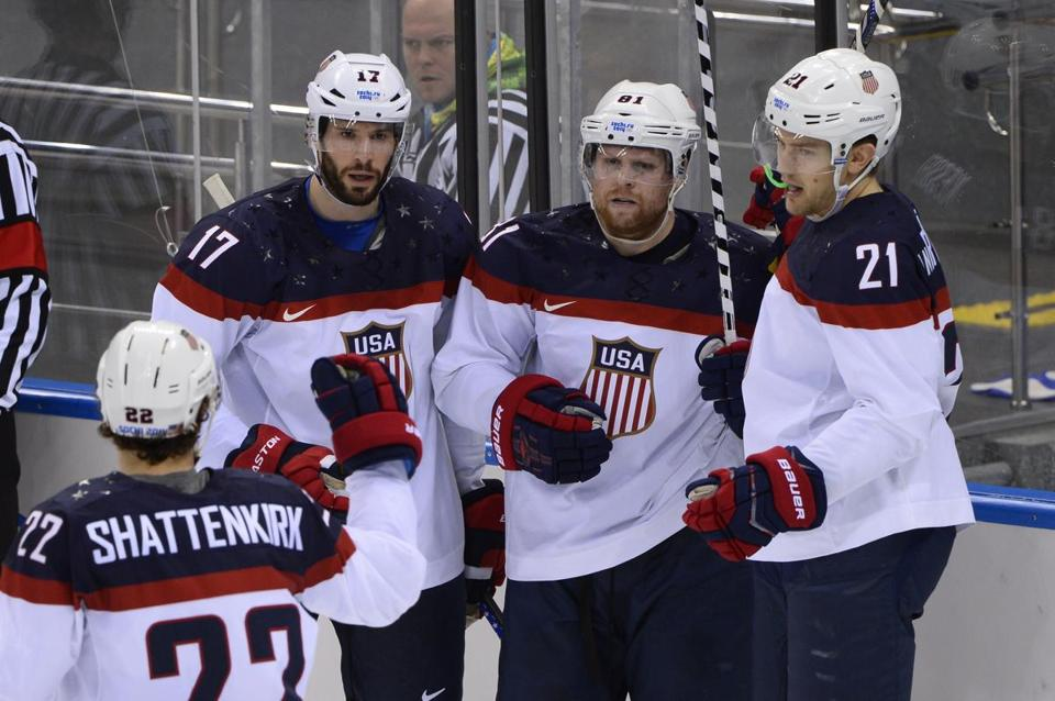 Kevin Shattenkirk, Ryan Kesler (17), Phil Kessel and James van Riemsdyk (21) celebrate Kessel's goal that gave the US a 5-1 lead over the Czech Republic. AFP PHOTO / JONATHAN NACKSTRANDJONATHAN NACKSTRAND/AFP/Getty Images