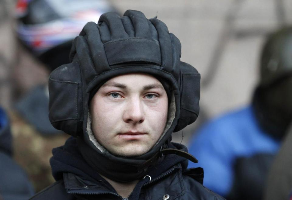 An antigovernment protester manned a barricade in Kiev Friday.