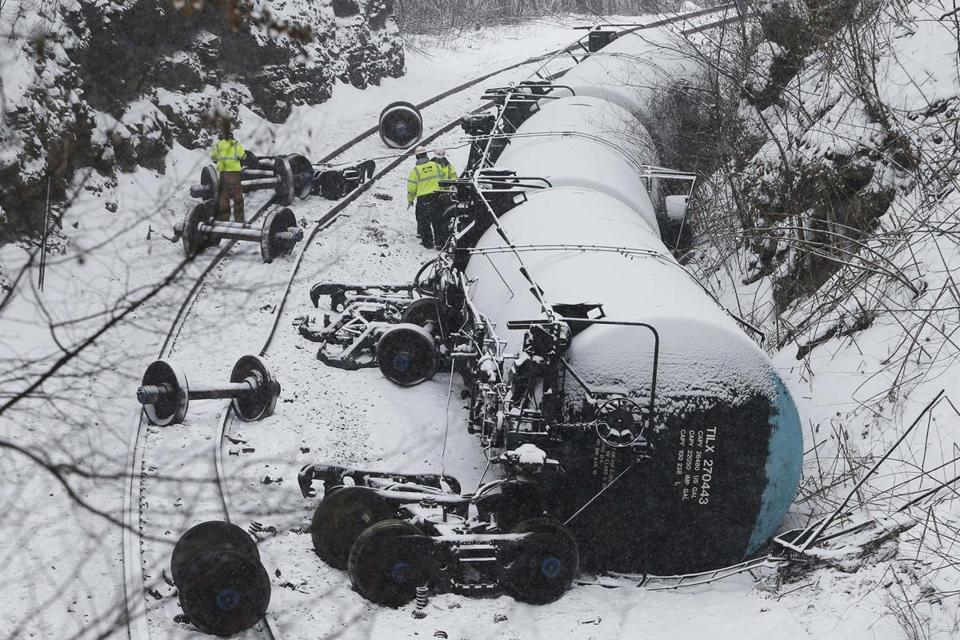 Emergency personnel examined overturned oil tank cars after a train derailment near Vandergrift, Pa., on Feb. 13.