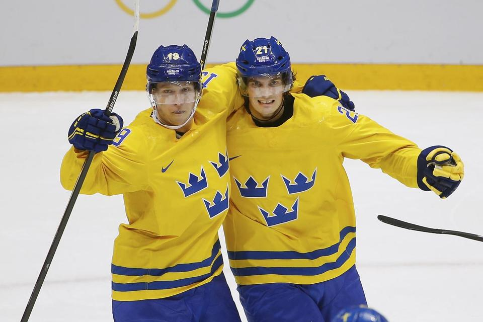 The Bruins'  Loui Eriksson, right, celebrated his goal against Finland with teammate Nicklas Backstrom.