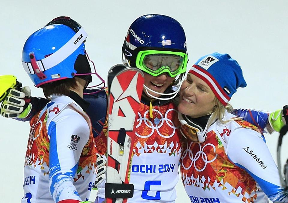 Bronze medallist s Kathrin Zettel of Austria, left, and silver medallist Marlies Schild celebrate with US gold medallist Mikaela Shiffrin.