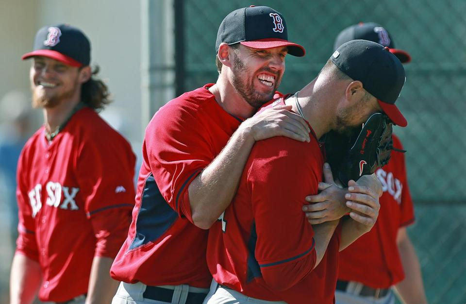 Clay Buchholz, John Lackey and Jon Lester, left to right, had some fun at a Red Sox workout on Thursday.