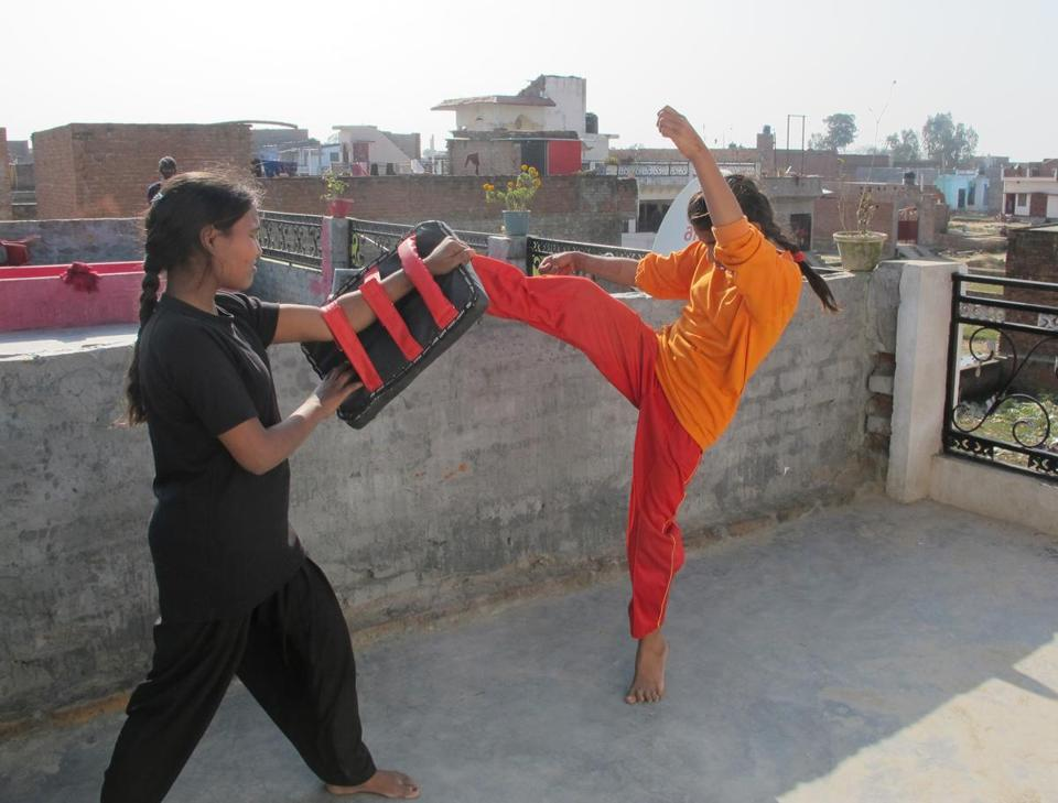 Members of the Red Brigade self-defense group practiced on a rooftop in Lucknow.