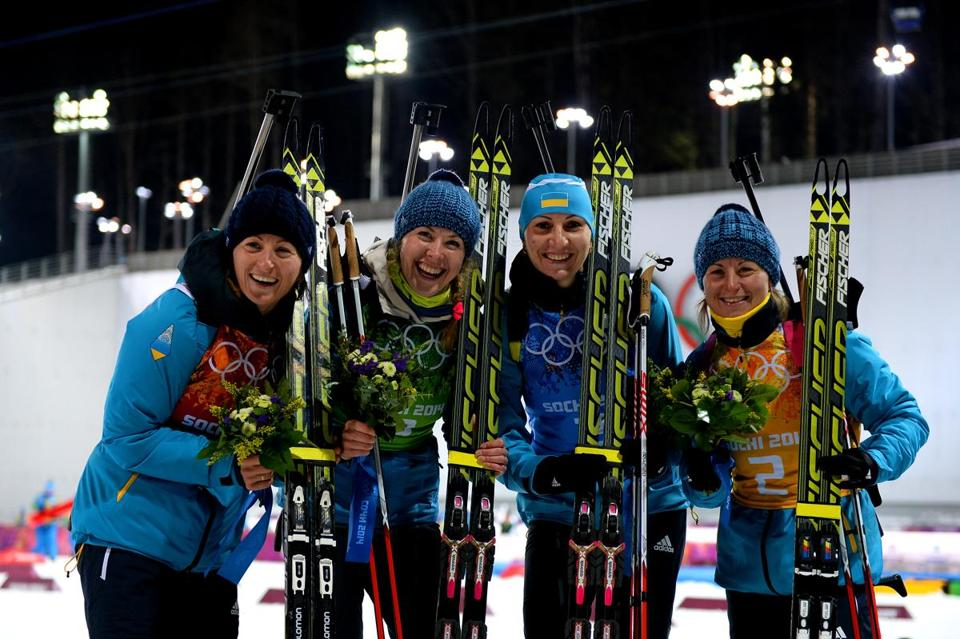 Ukrainian gold medalists (from left) Vita Semerenko, Juliya Dzhyma, Olena Pidhrushna and Valj Semerenko celebrated after their victory in the 4 x 6-kilometer biathlon relay.