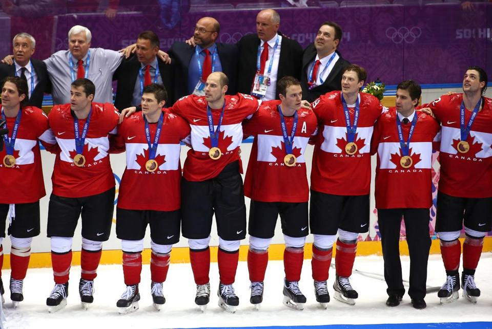 Canadian team members listened to their national anthem after receiving their gold medals.