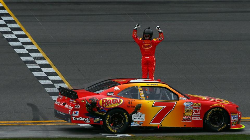Regan Smith celebrated after winning Saturday's NASCAR Nationwide Series DRIVE4COPD 300 at Daytona International Speedway.