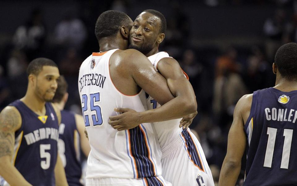 The Grizzlies kept streaking Al Jefferson (left) in check, but they had no answer for Kemba Walker, who scored 31 points in Charlotte's victory.
