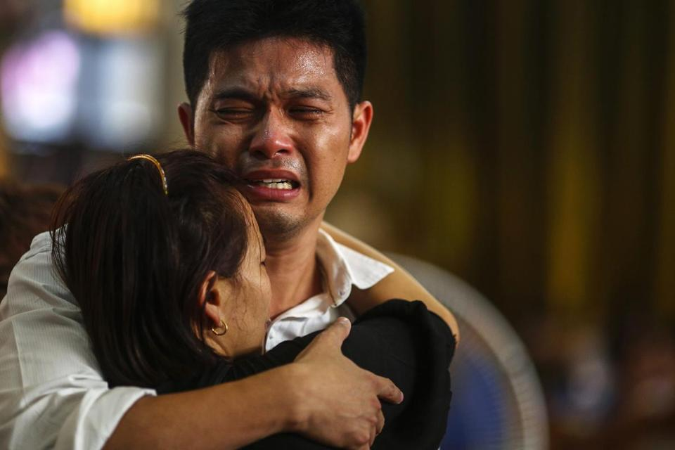 Tayakorn Yos-ubon, the father of two children killed in a bomb blast Sunday near an anti-government protest, grieved during their funeral in Bangkok on Monday.