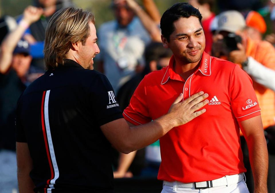 Victor Dubuisson (left) offers congratulations to Jason Day.