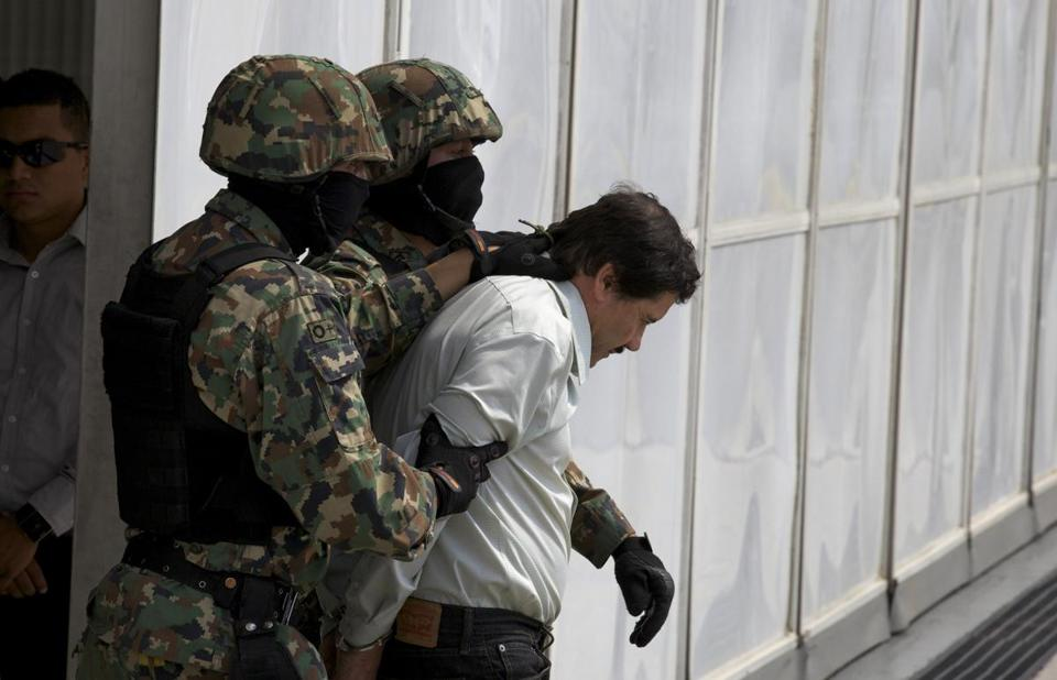 Joaquin ''El Chapo'' Guzman was escorted to a helicopter in handcuffs by Mexican navy marines on Saturday.