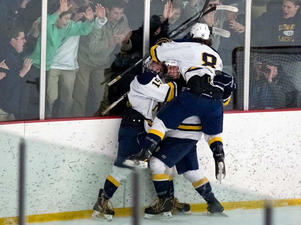 Xaverian's Jon Beniers (19) and Connor McCarthy (8) party with teammate Ricky Smith after his goal in the second OT.