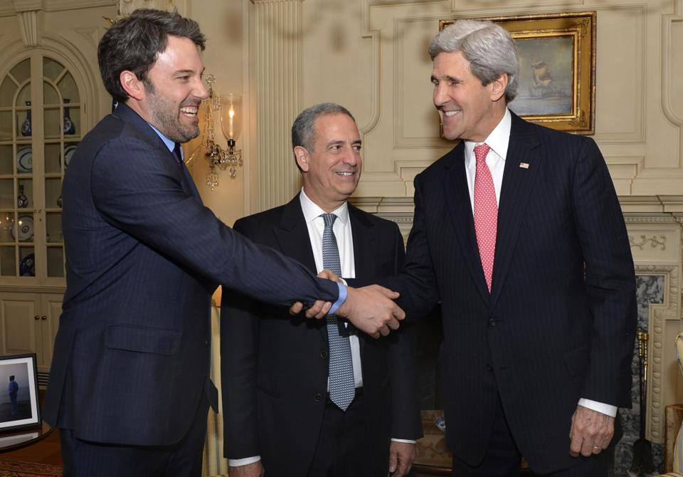 From left: Ben Affleck, former Senator Russ Feingold, and Secretary of State John Kerry at the State Department.