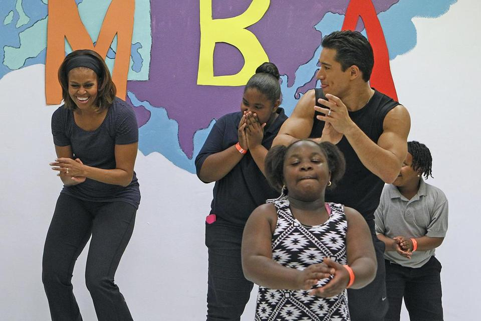 "Michelle Obama participated in a zumba class with Mario Lopez in Miami Tuesday to promote her ""Let's Move"" campaign."