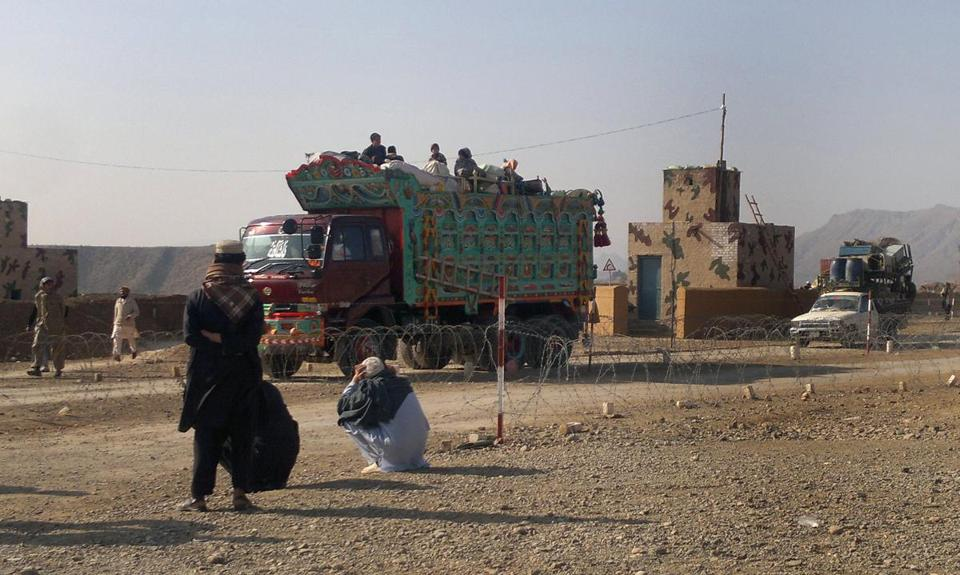 Tribal families crossed through a military checkpoint Monday in North Waziristan. Air strikes had hit Taliban hideouts in the area.