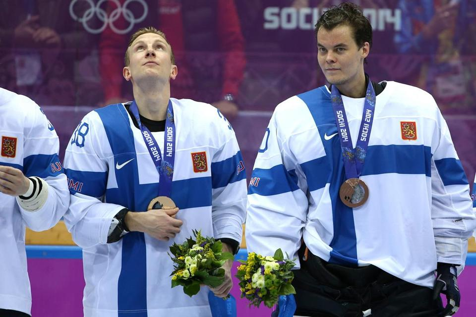 Tuukka Rask (right) backstopped the Finnish team to the bronze medal in Sochi.