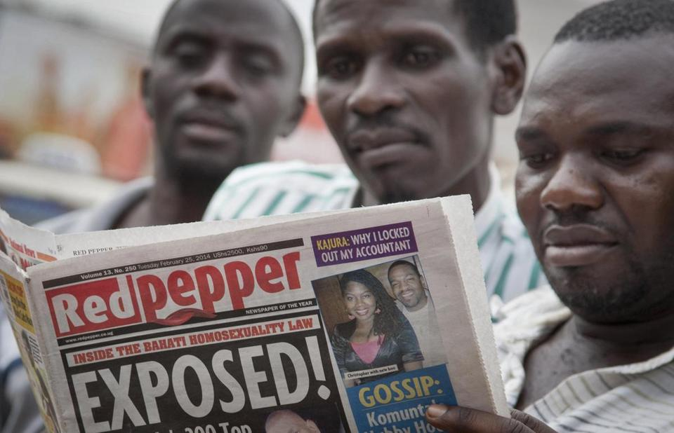 "Ugandans read a tabloid Tuesday that published a list of what it called the country's ""200 top homos,"" one day after President Yoweri Museveni enacted a harsh antigay law."