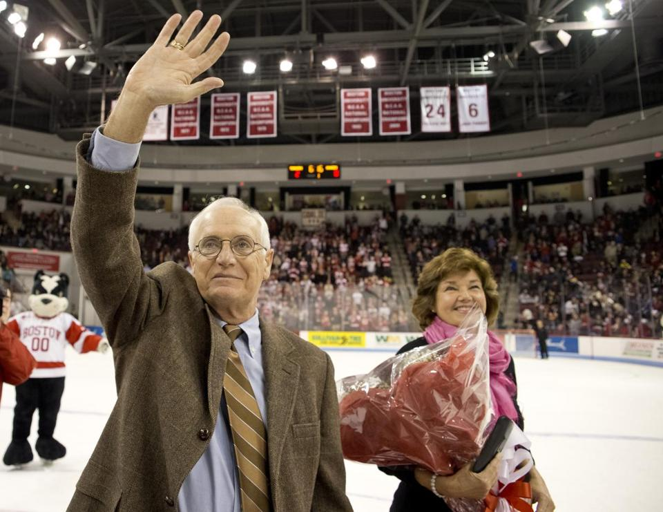Jack Parker, who stepped down as Boston University's hockey coach last year, waved to the student section after his number was retired during a ceremony between the first and second periods of the game against Northeastern University. Standing next to him is his wife, Jacqueline.