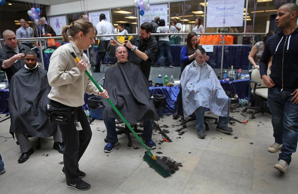 Lorna Fargo of CM Cleaning (left) swept up after the event, which benefits the Dana-Farber Cancer Institute in Boston.