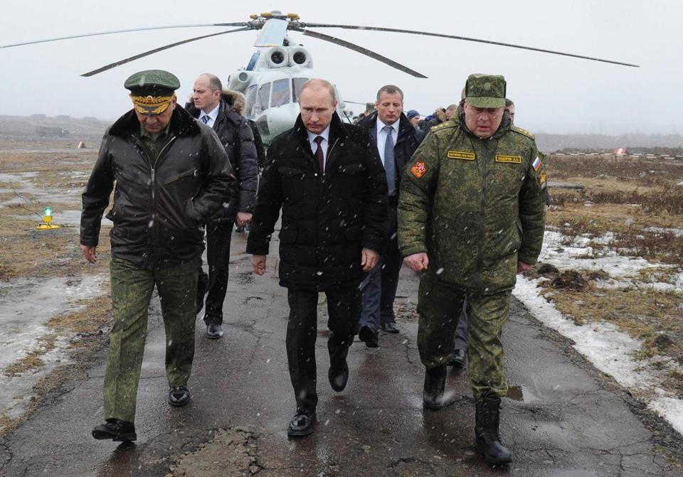 President Vladimir Putin, with Defense Minister Sergei Shoigu (left) and other officials, observed military exercises near St. Petersburg.
