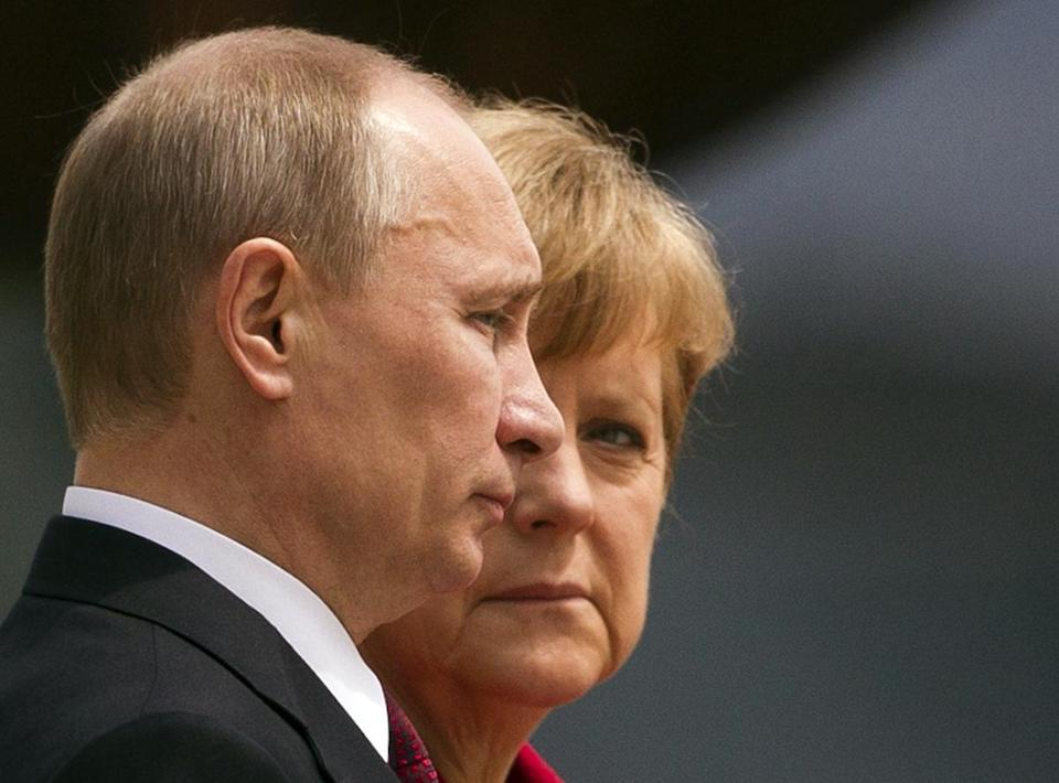 German Chancellor Angela Merkel looks at Russian President Vladimir Putin before talks in Berlin in 2012.