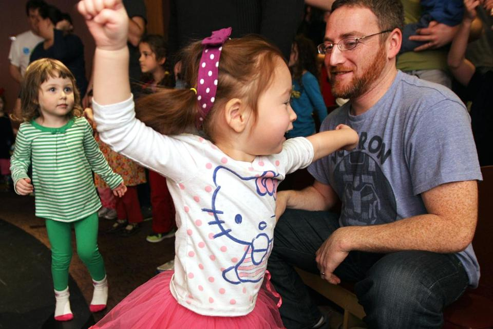 Two-year-old Lilo danced in front of her father, Coley O'Toole, at a Purim event at the Boston Children's Museum.